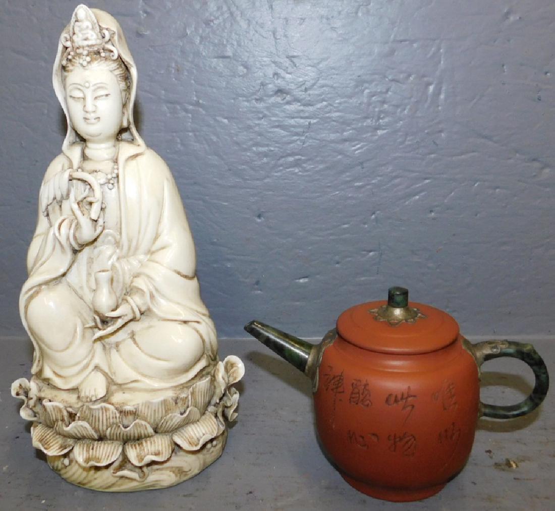 Terra cotta tea pot and Porcelain Quin Yan figure.