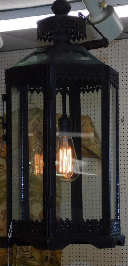 Hanging hexagonal glass pane & pierced tin lantern.