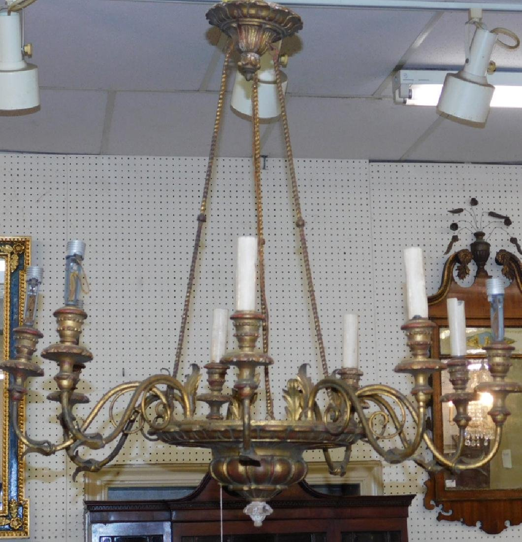9 light gilt metal and wood hanging chandelier.