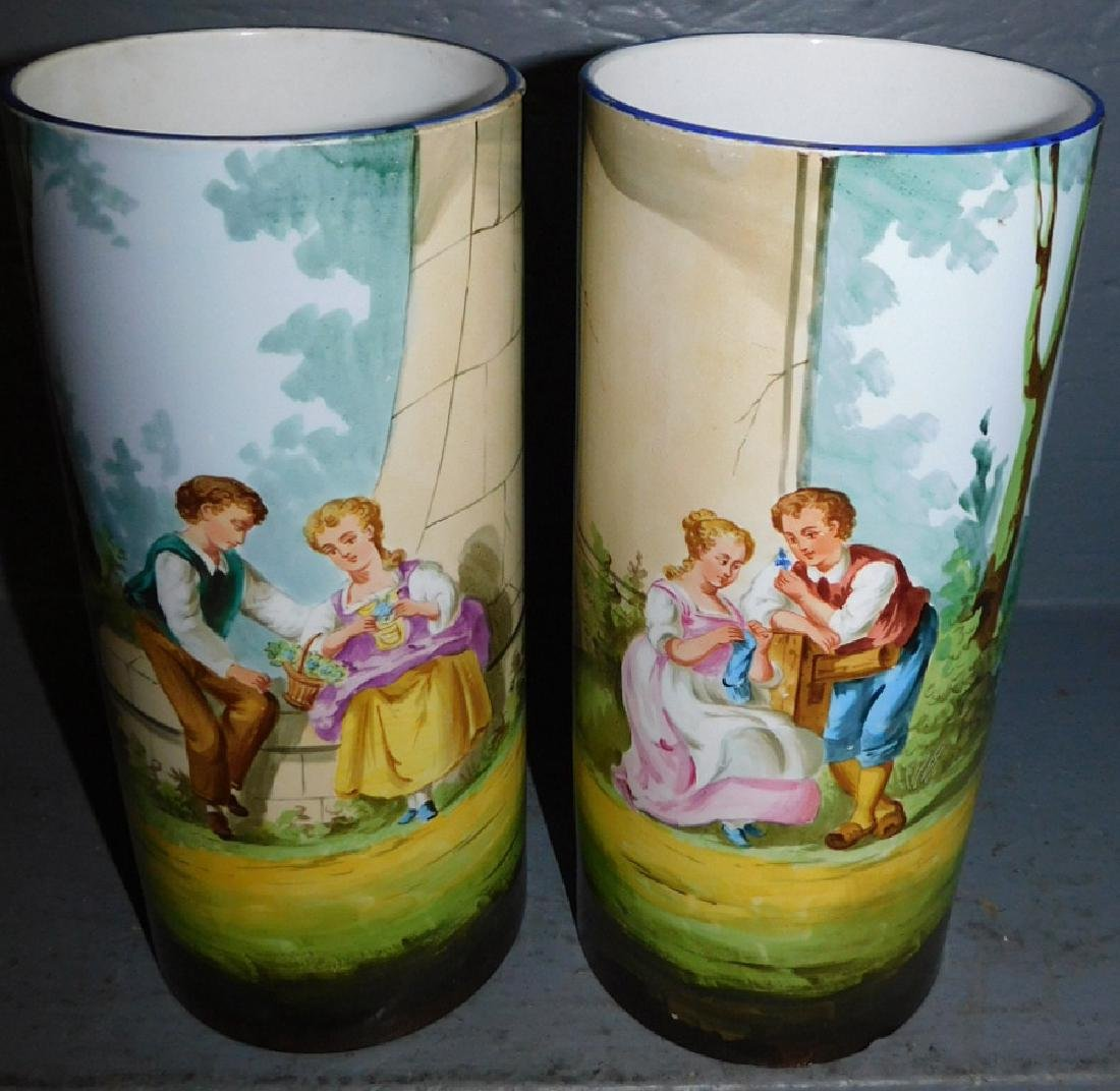 Pr hand painted courting scene porcelain vases.