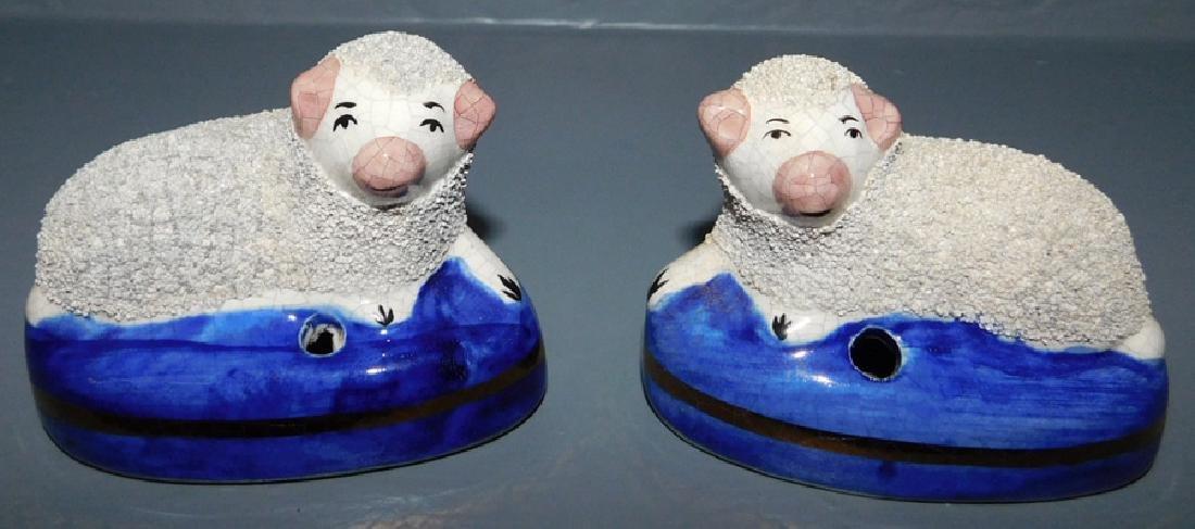 "2 Staffordshire sheep inkwells. 3 1/4"" long."