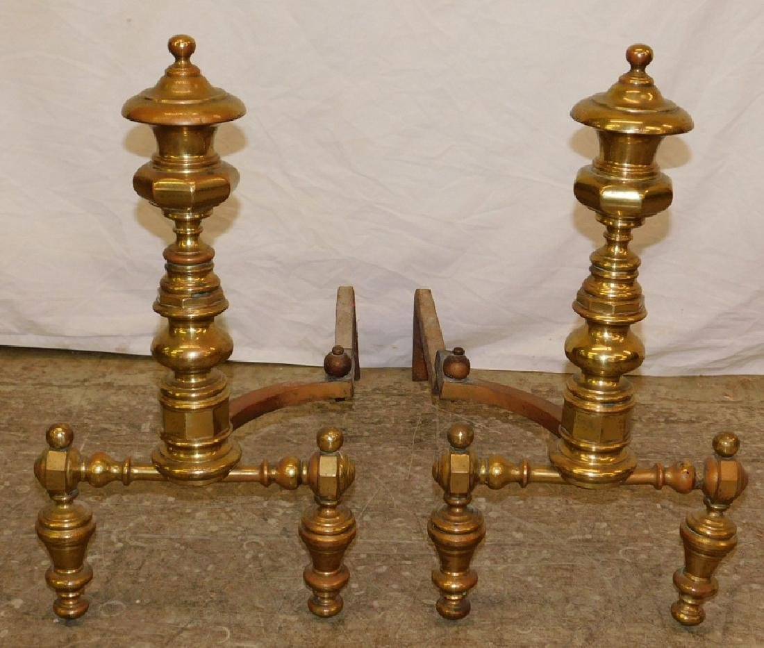 """Pair of heavy brass andirons. 23"""" tall."""