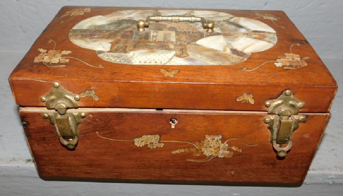 Mother of pearl inlaid walnut lock box.