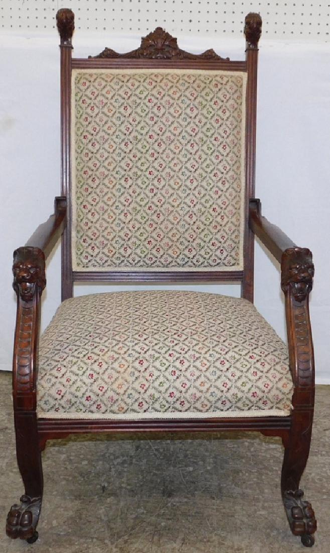 "Carved walnut Victorian arm chair. 46"" tall."