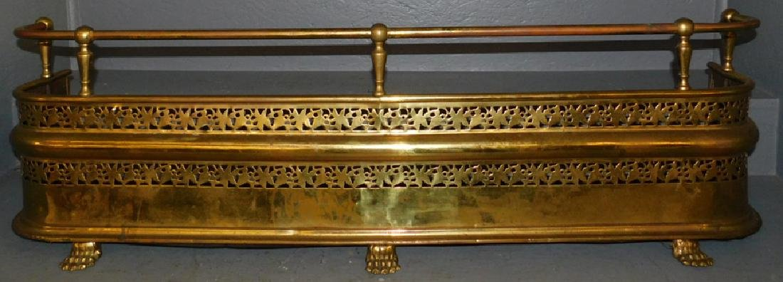 """Reticulated brass footed fire fender. 47"""" long."""
