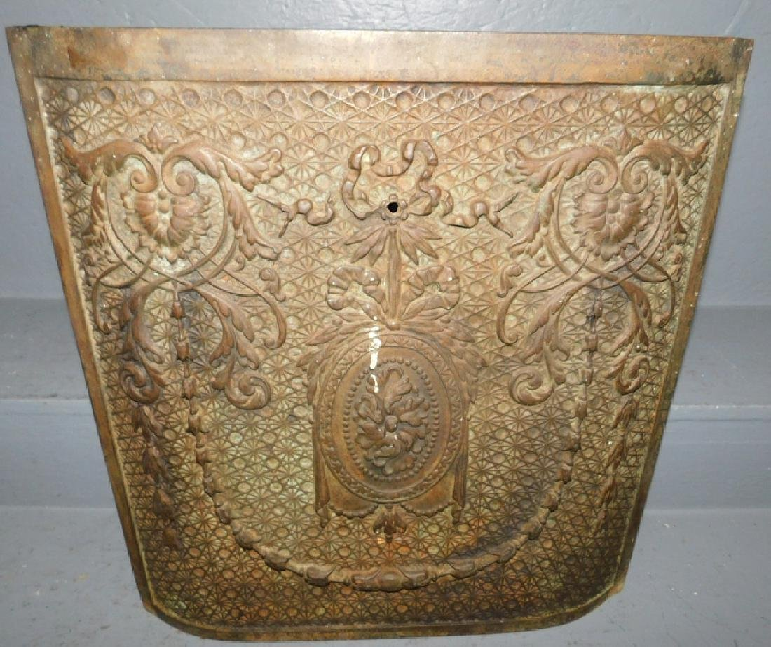 """Cast iron molded fireplace cover. 18"""" x 21""""."""