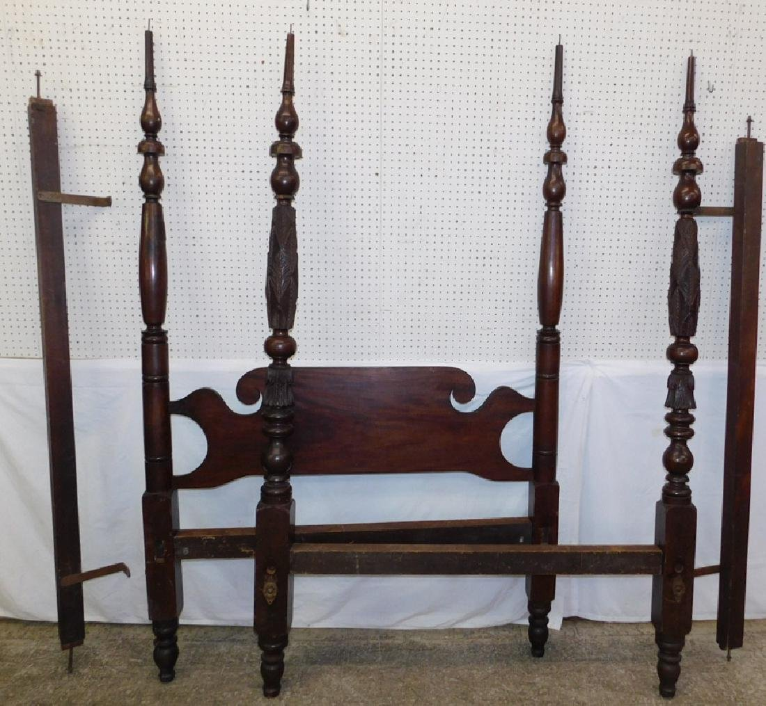 19th c American carved footboard canopy bed.
