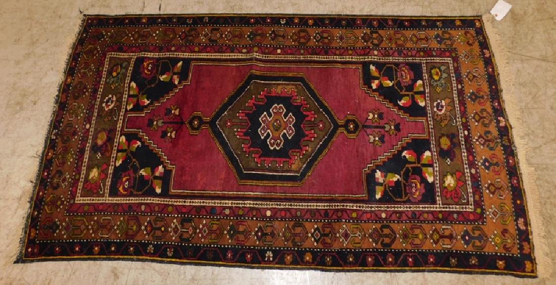 "6' x 3'6"" antique Oriental rug"