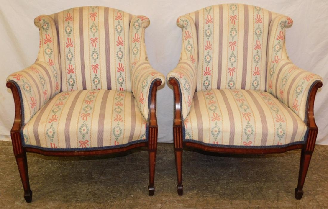 Pair of inlaid mahogany upholstered arm chairs.