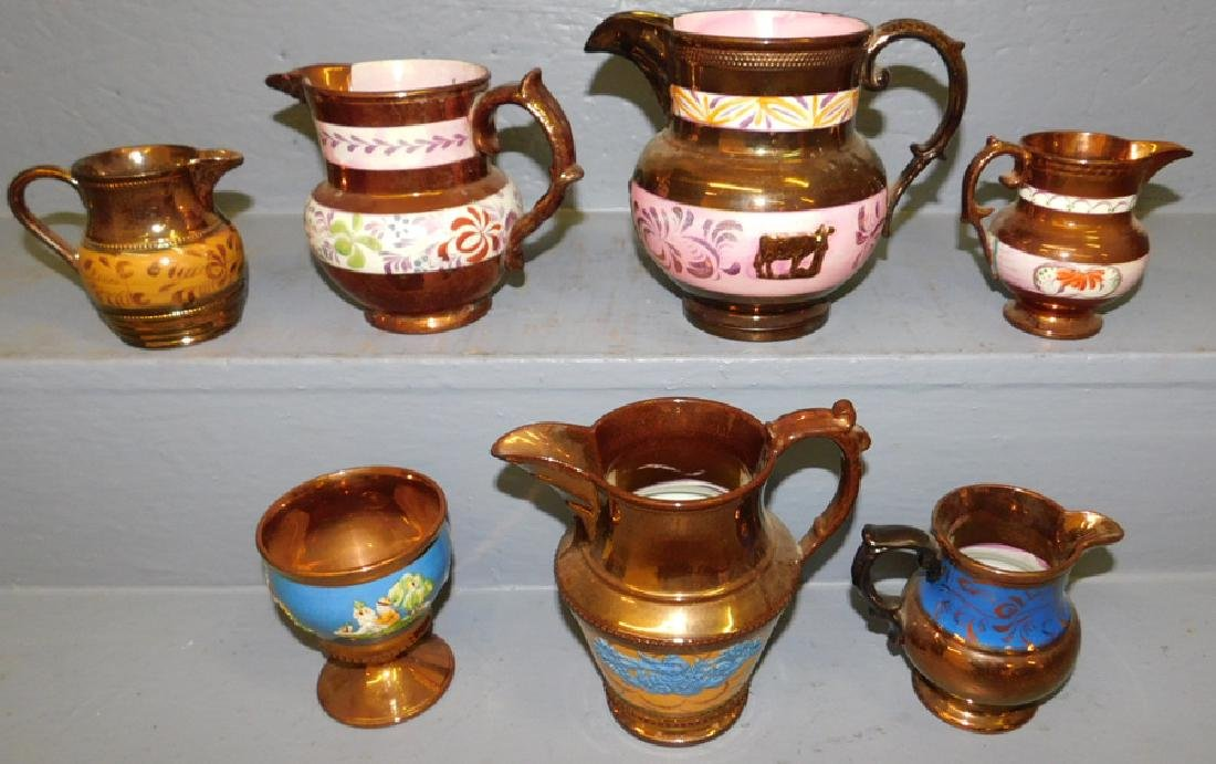 6 copper luster pitchers and mug.