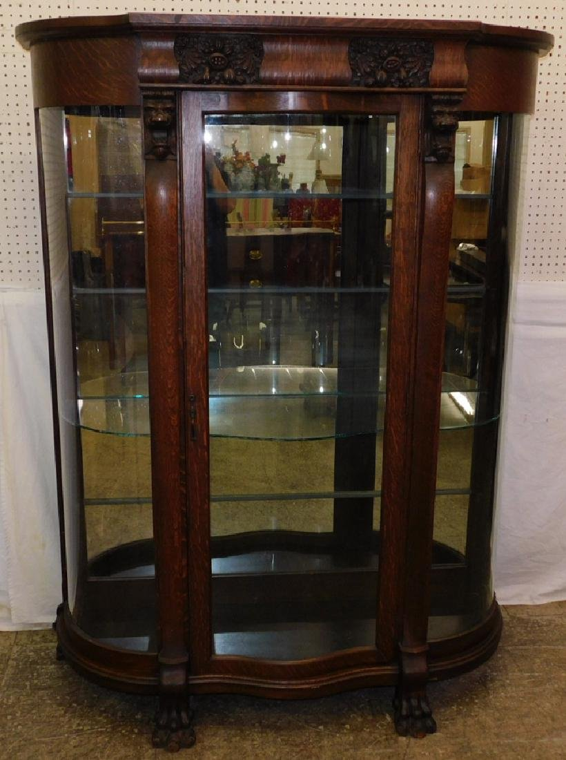 American lions head china cabinet with claw feet.