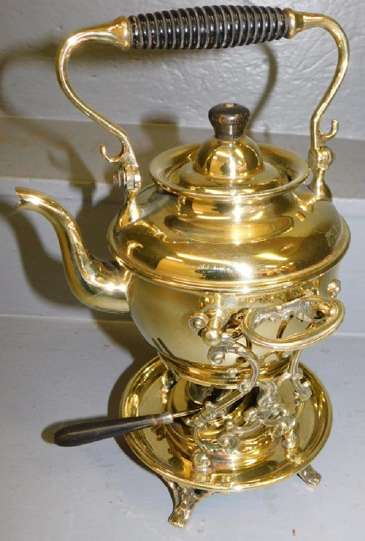 Polished Brass kettle on stand.