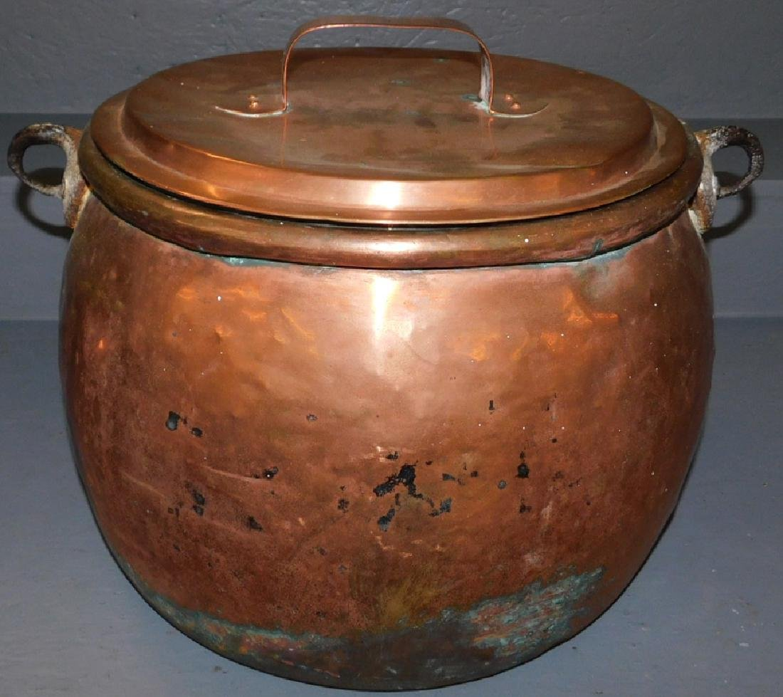 Large copper covered urn.