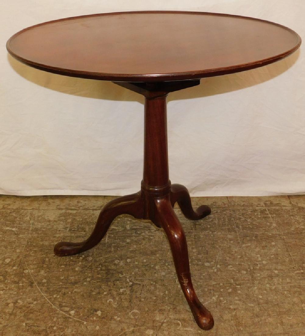 Mahogany Queen Anne pie crust tilt top tea table.