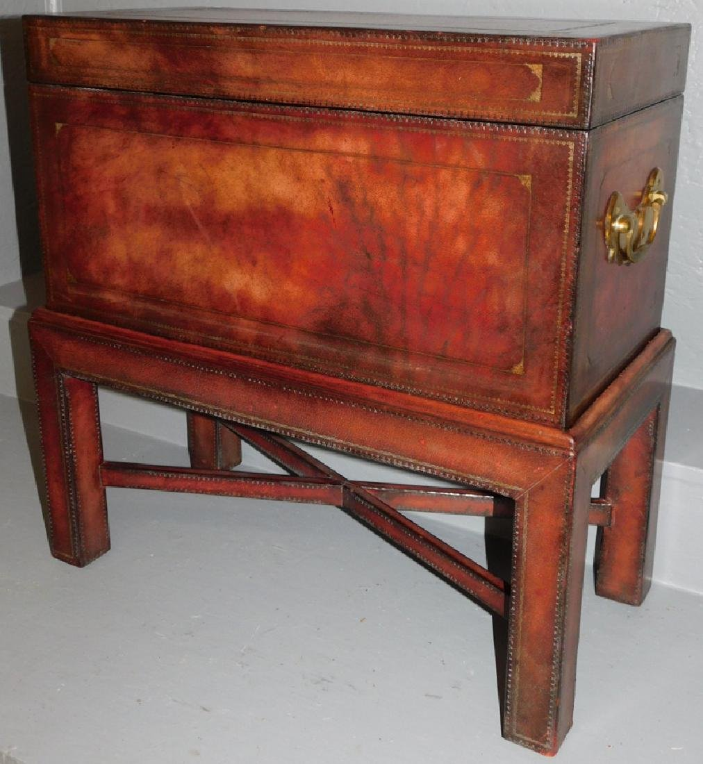 Tooled leather Maitland Smith box on stand.