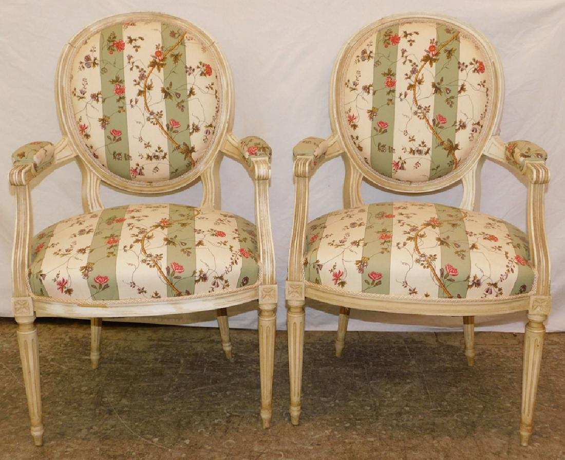 Pair of French painted fauteuils.