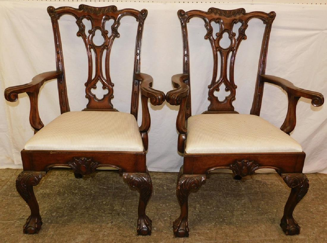 Pair of Chippendale arm chairs.