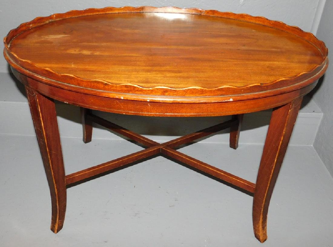 Inlaid mahogany piecrust top tea table.