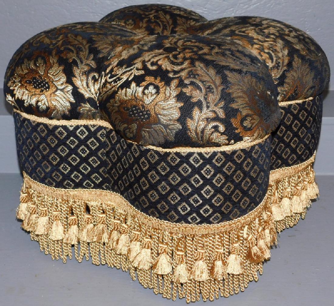 Black & gold upholstered pouf ottoman.