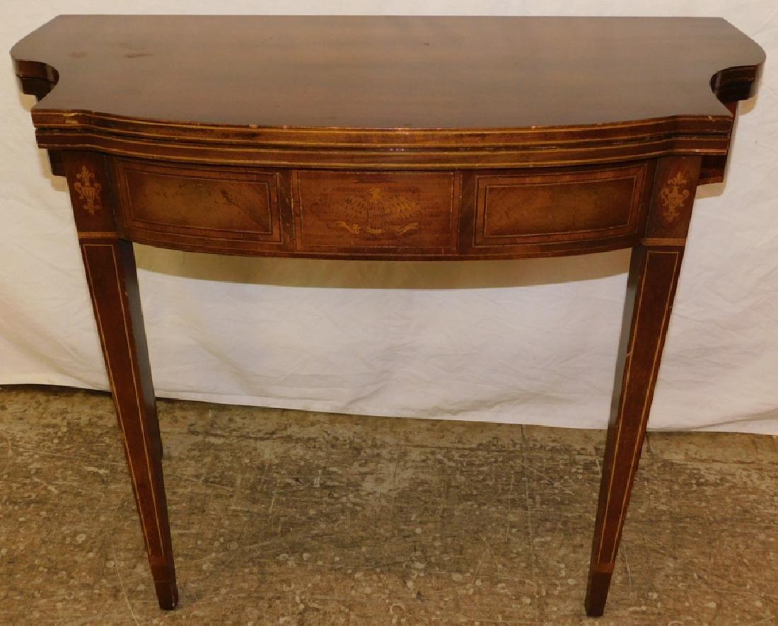 Inlaid mahogany game table.