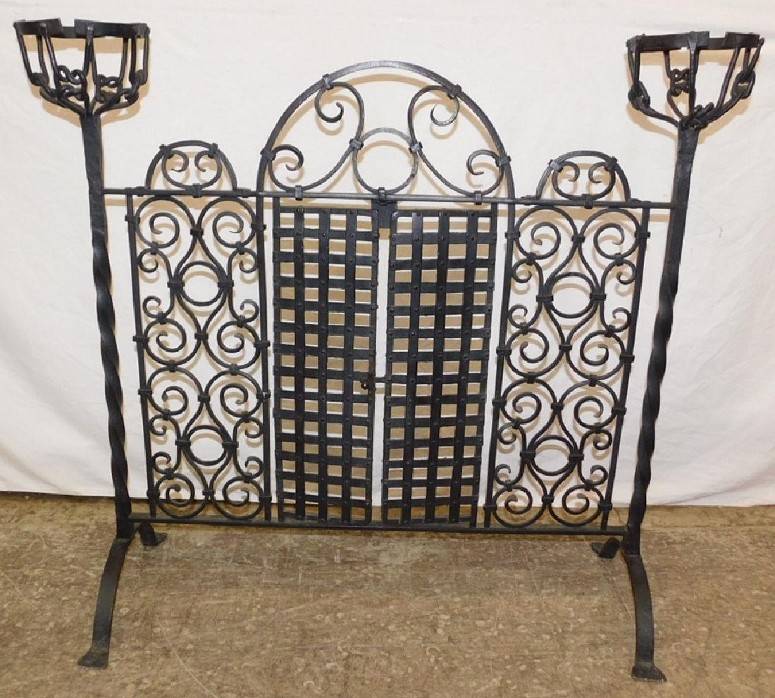 Ornate Spanish wrought iron fire screen.