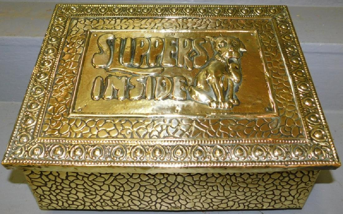 Embossed brass slipper box.