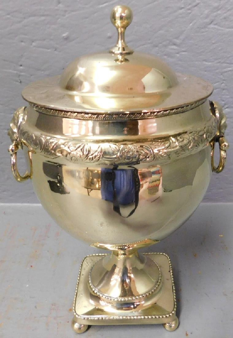 Brass footed covered urn.