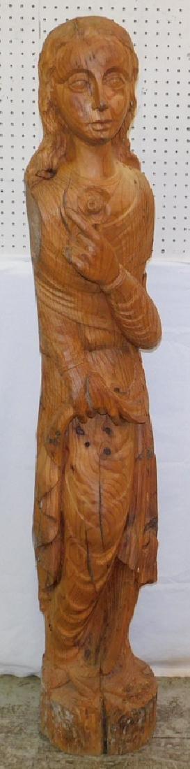 Lrg yellow pine wormwood carved female figure.