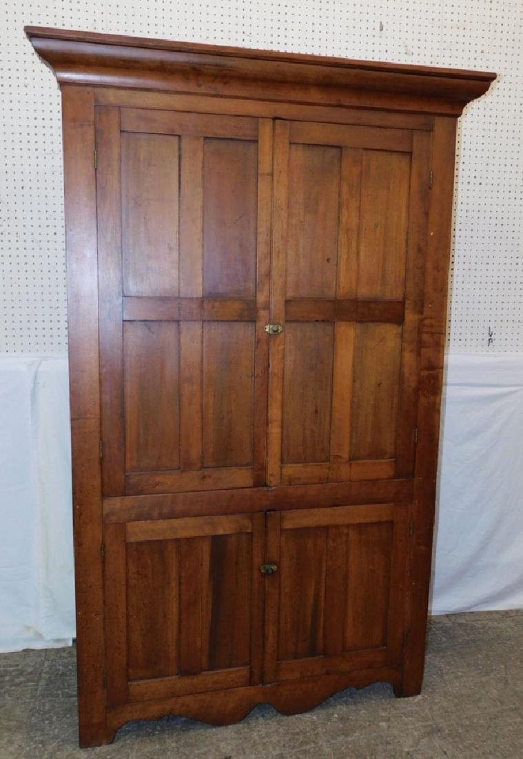 19th C one piece cherry corner cupboard.