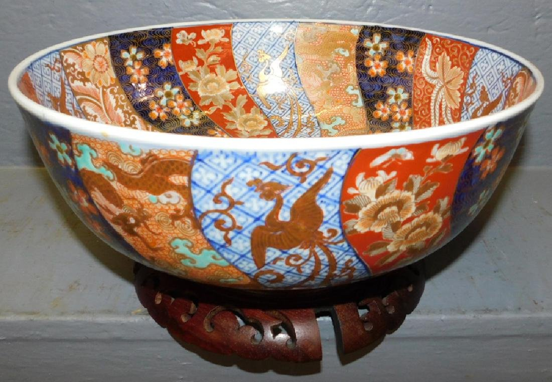 Large Imari gold decorated bowl and stand.