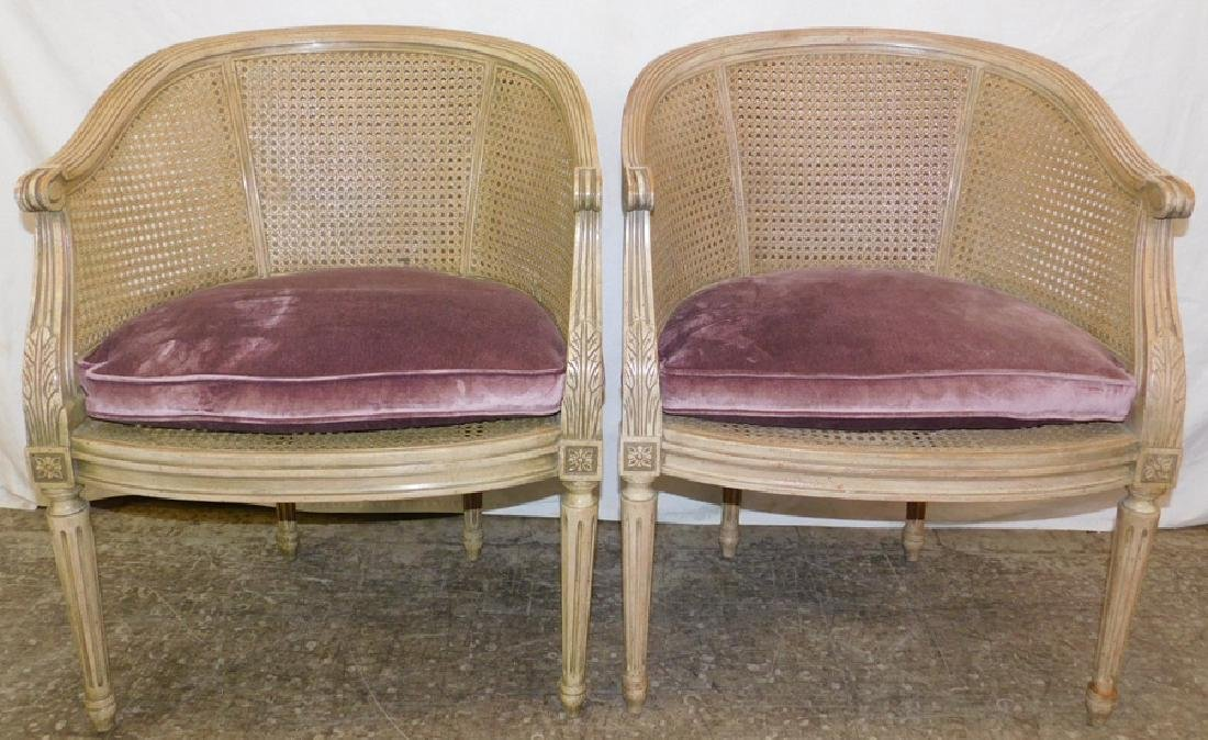 Pair French barrel back and cane seat bergeres.