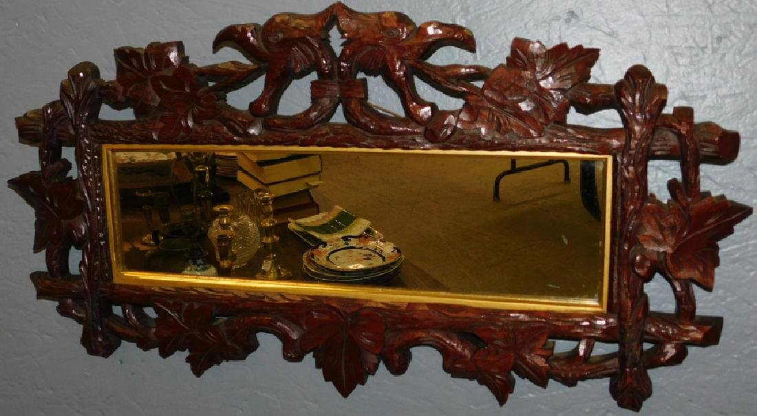Carved walnut Black Forest mirror. .