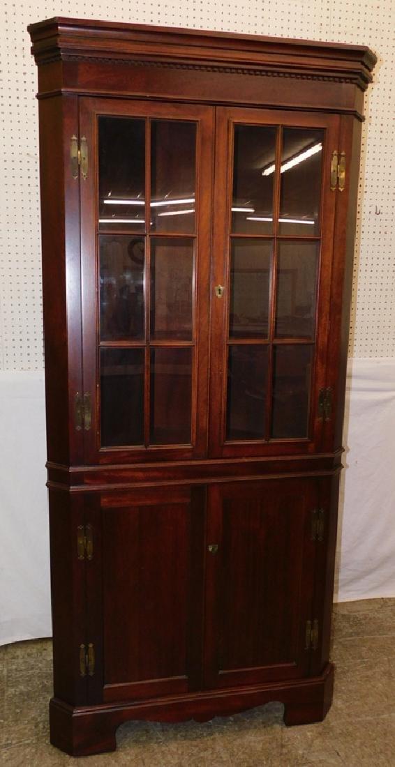 Craftique mahogany glass front corner cabinet.