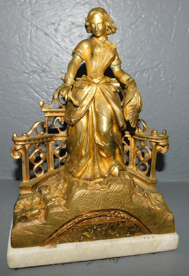 Gilt bronze figure on marble base.