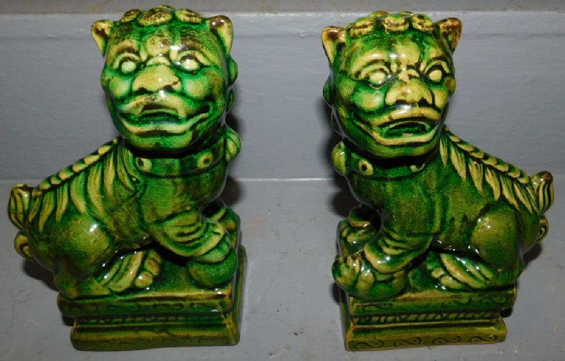 Pair of spinach green Chinese Foo dogs.