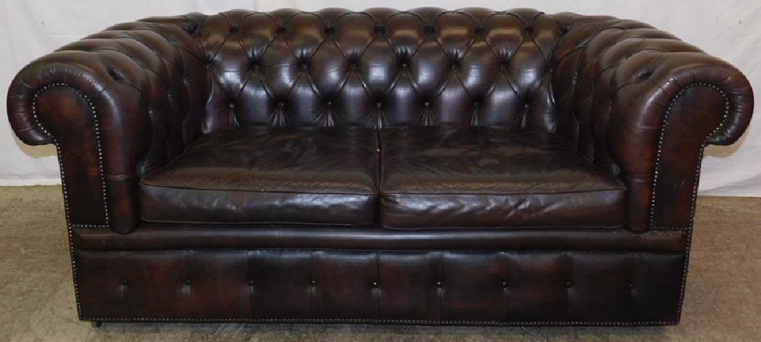 Brown tufted leather Chesterfield sofa.