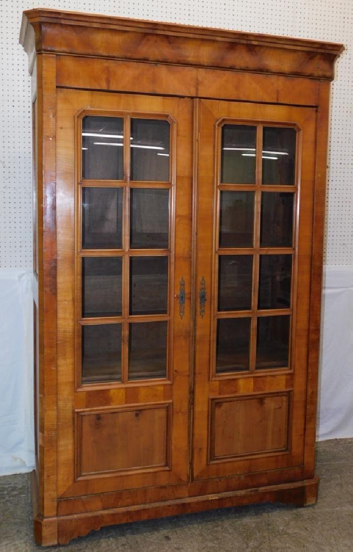 Bleached walnut glass front Biedermeier cupboard.