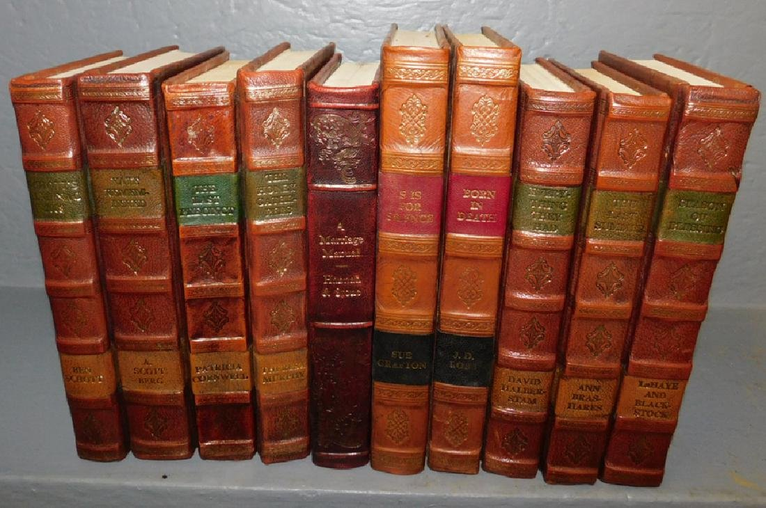 10 mixed leather bound books.