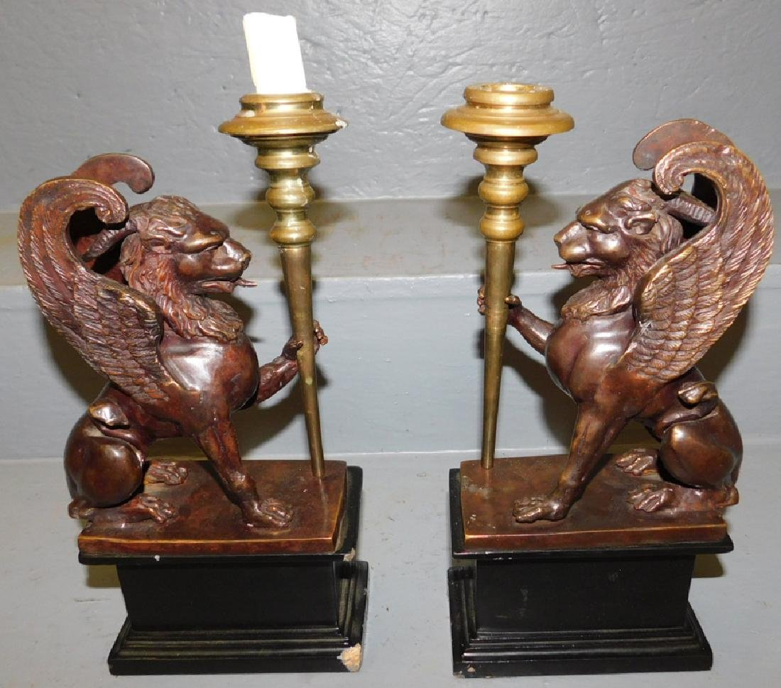 Pair of bronze gryphon candlesticks.