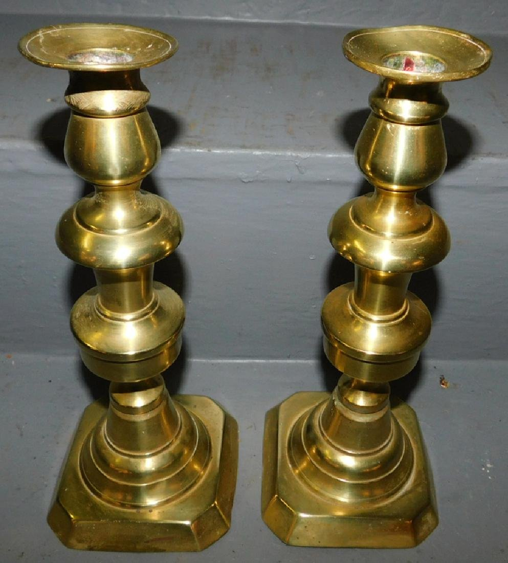 Pair of early push up brass candlesticks.