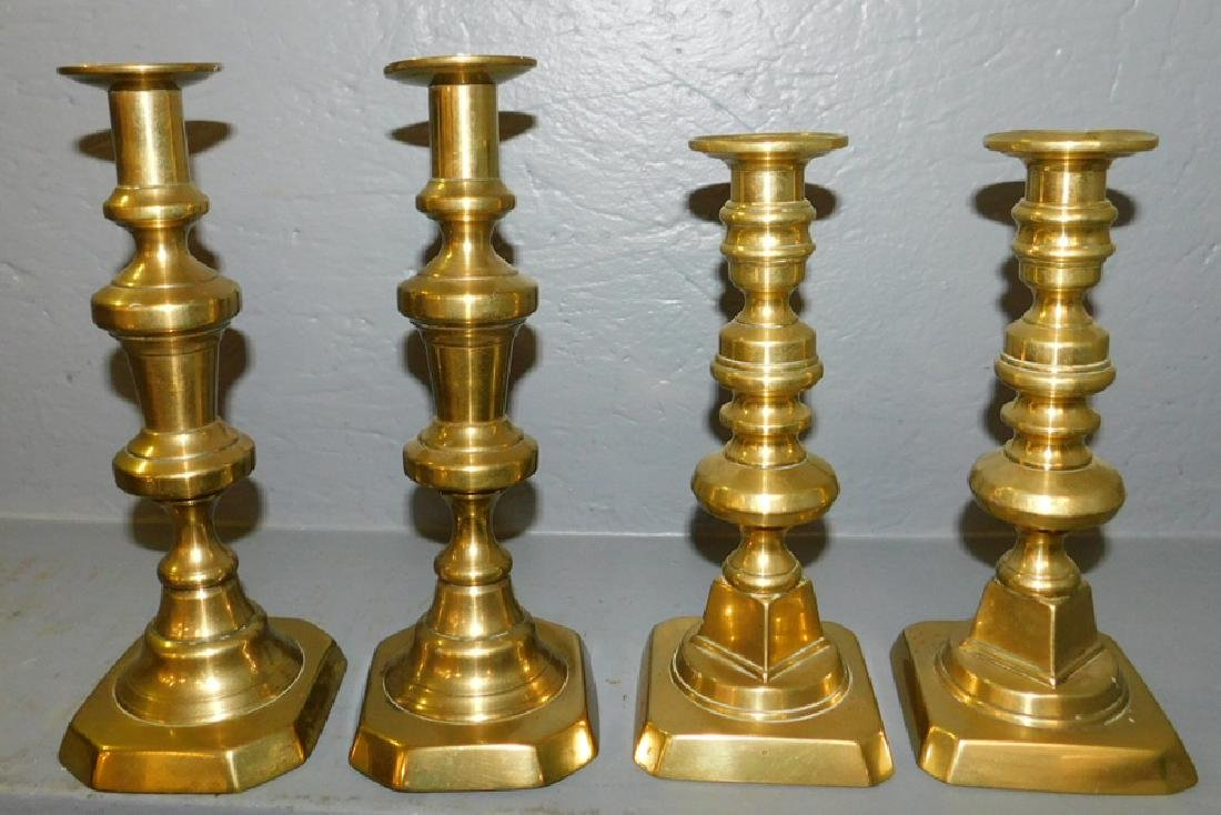 2 pair of early 19th C brass push up candlesticks.