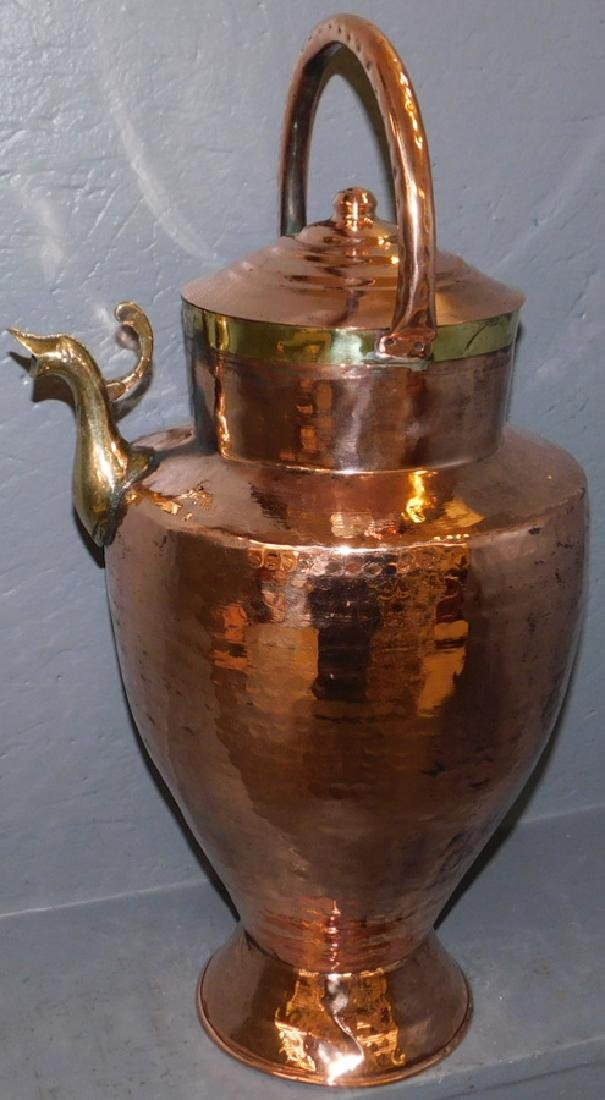 Copper and brass covered pitcher.