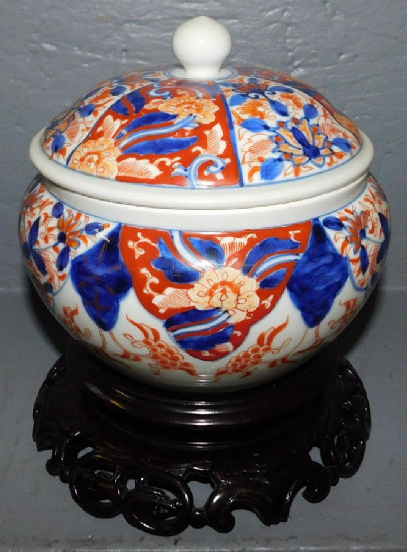 Covered Imari jar on stand.