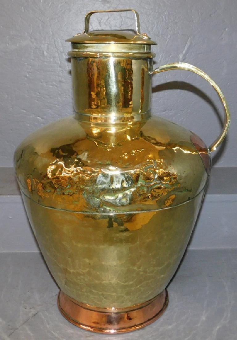 Large brass copper rimmed wine jug.