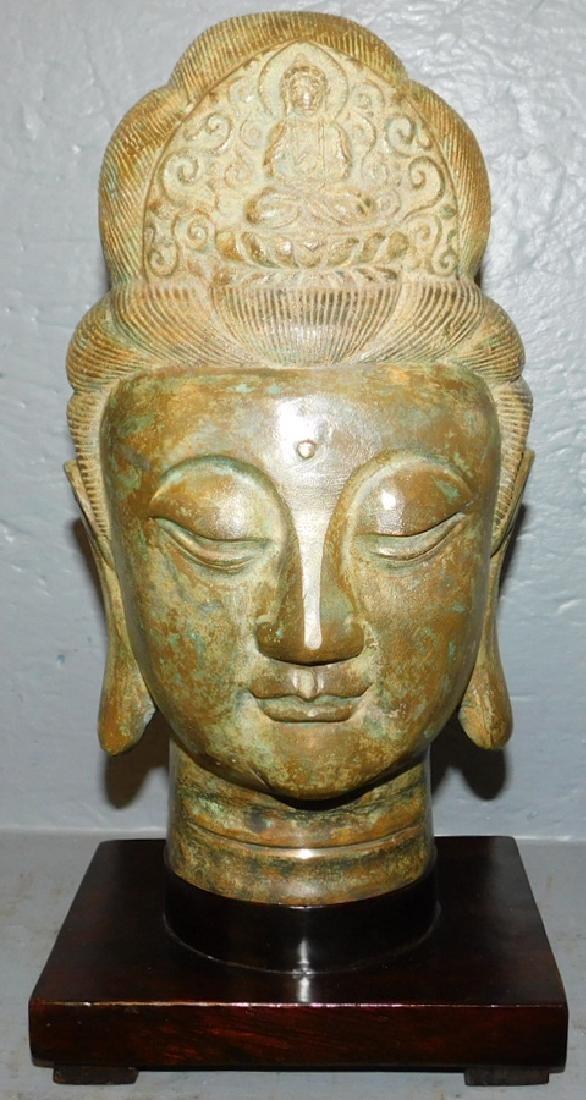 Bronze India Buddha head with teakwood base.