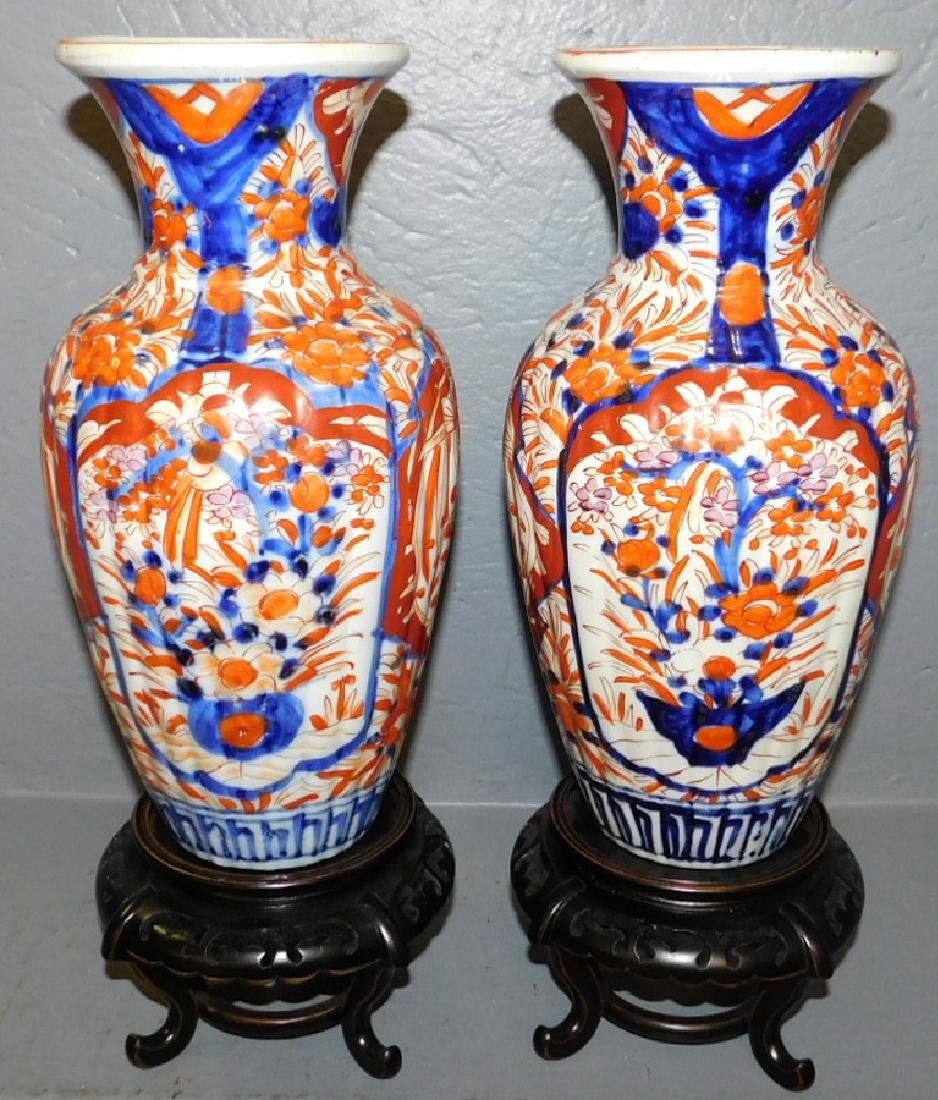 Pair of 19th C Imari vases with stands.