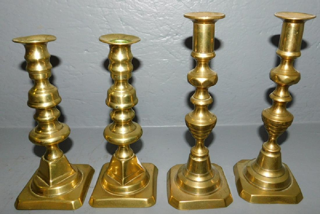 2 pair of early push up brass candlesticks.