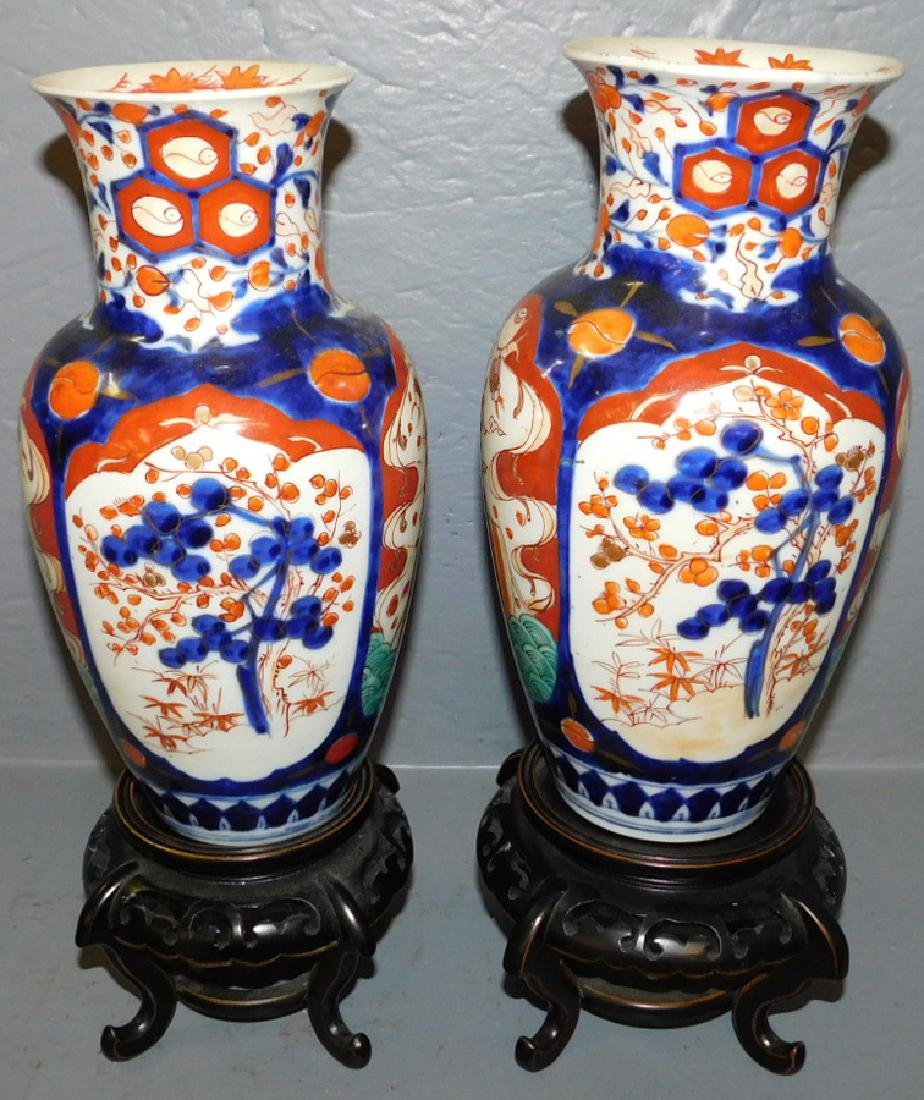 Pair of 19th Imari vases with stands.