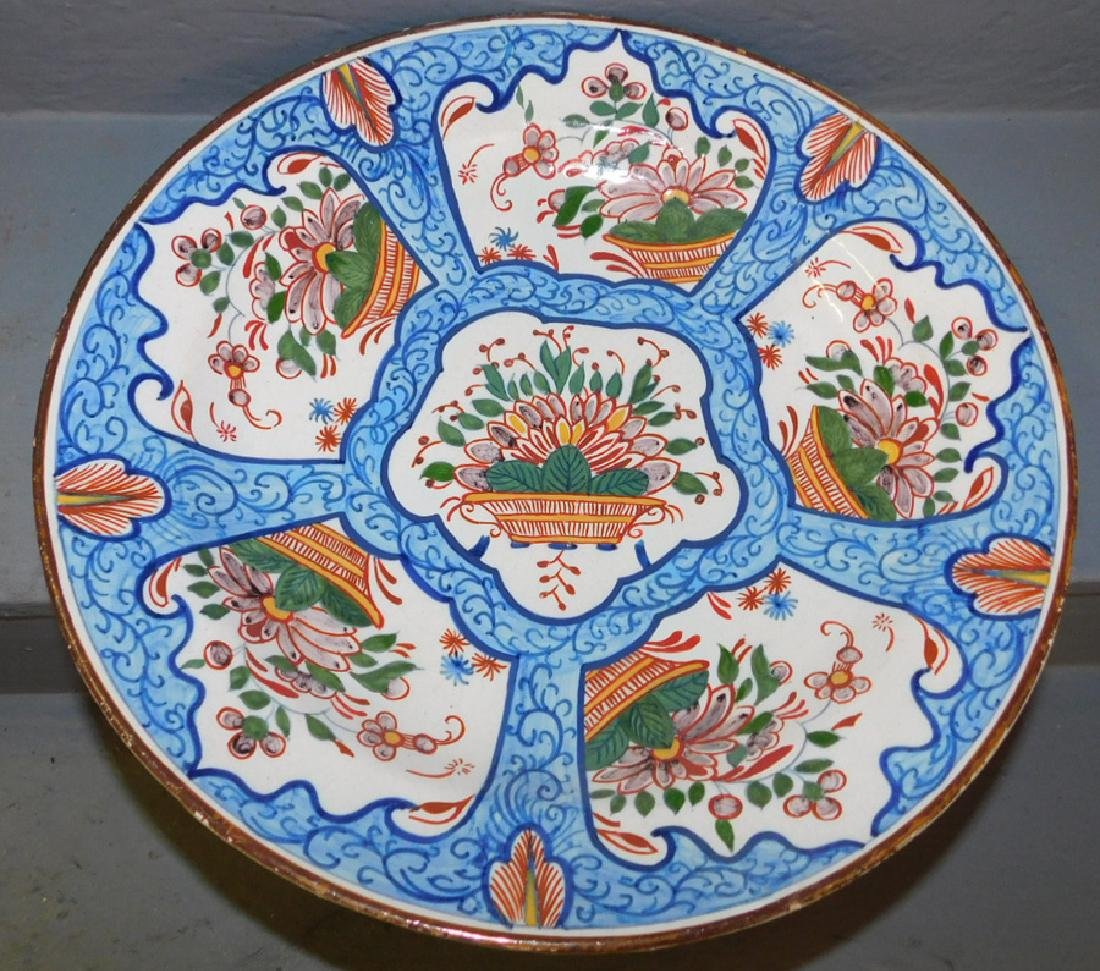 19th C polychrome Delft charger.