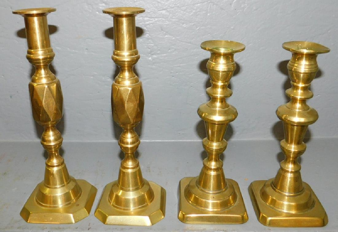 2 pair of 19th C brass pushup candlesticks.